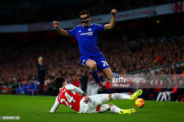 Hector Bellerin of Arsenal slides in on Cesar Azpilicueta of Chelsea during the Barclays Premier League match between Arsenal and Chelsea at Emirates...
