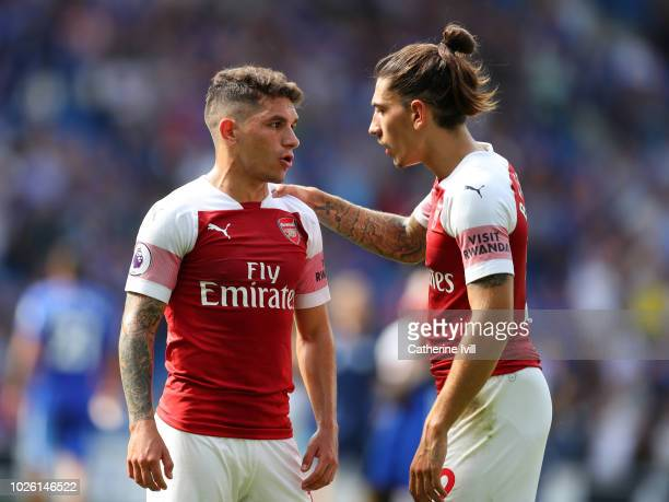 Hector Bellerin of Arsenal speaks to Lucas Torreira of Arsenal during the Premier League match between Cardiff City and Arsenal FC at Cardiff City...