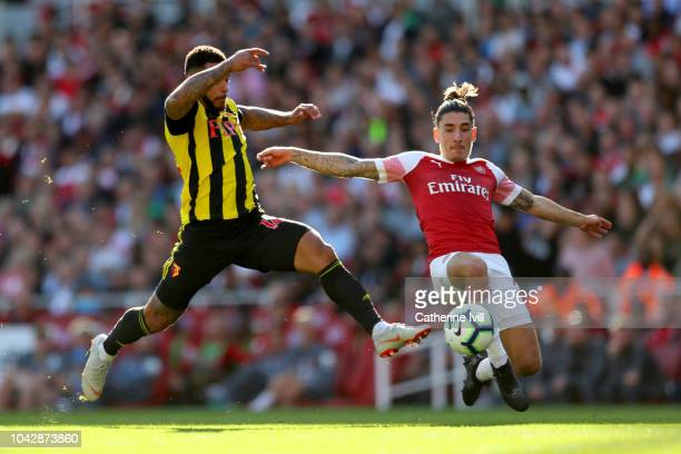 Hector Bellerin of Arsenal tackles Andre Gray of Watford during the Premier League match between Arsenal FC and Watford FC at Emirates Stadium on...