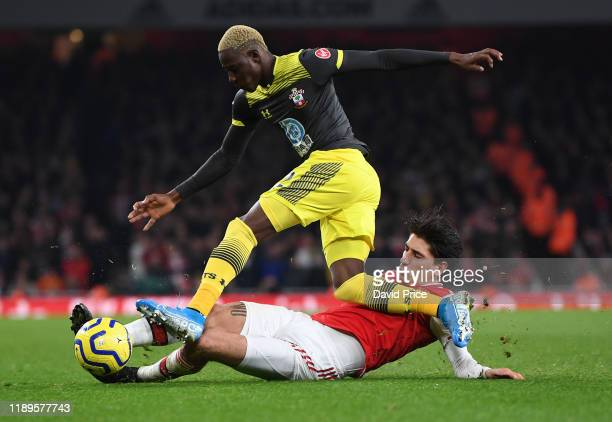 Hector Bellerin of Arsenal tackles Moussa Djenepo of Southampton during the Premier League match between Arsenal FC and Southampton FC at Emirates...