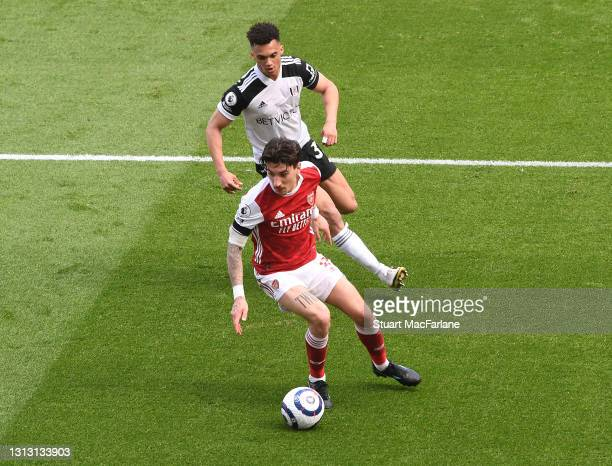 Hector Bellerin of Arsenal takes on Antonee Robinson of Fulham during the Premier League match between Arsenal and Fulham at Emirates Stadium on...