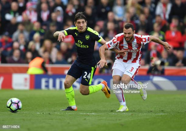 Hector Bellerin of Arsenal takes on Erik Pieters of Stoke during the Premier League match between Stoke City and Arsenal at Bet365 Stadium on May 13...
