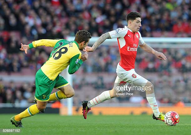Hector Bellerin of Arsenal takes on Gary O'Neil of Norwich during the Barclays Premier League match between Arsenal and Norwich City at on April 30th...
