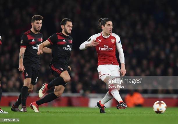 Hector Bellerin of Arsenal takes on Hakan Calhanoglu of Milan during the match between Arsenal and AC Milan at Emirates Stadium on March 15 2018 in...