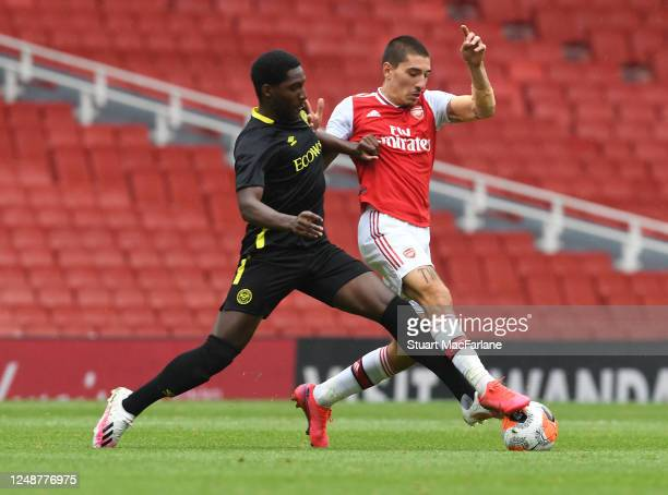 Hector Bellerin of Arsenal takes on Halil Dervisoglu of Brentford during a friendly match between Arsenal and Brentford at Emirates Stadium on June...