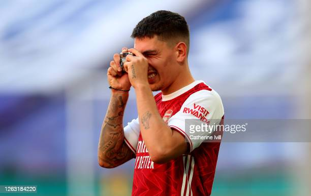 Hector Bellerin of Arsenal takes photos on his camera after his teams victory in the Heads Up FA Cup Final match between Arsenal and Chelsea at...