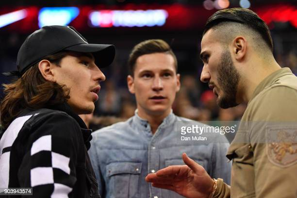 Hector Bellerin of Arsenal talks with Sead Kolasinac of Arsenal and Julian Draxler of Paris SaintGermain during the NBA game between Boston Celtics...
