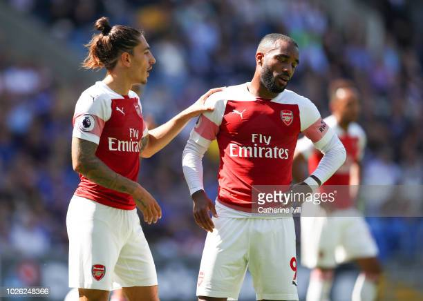 Hector Bellerin of Arsenal with Alexandre Lacazette of Arsenal during the Premier League match between Cardiff City and Arsenal FC at Cardiff City...