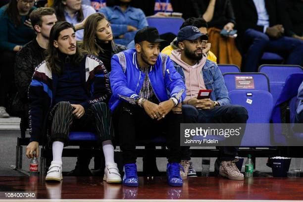 Hector Bellerin Pierre Emerick Aubameyang and Alexandre Lacazette players of Arsenal watch the game during the NBA game against Washington Wizards...