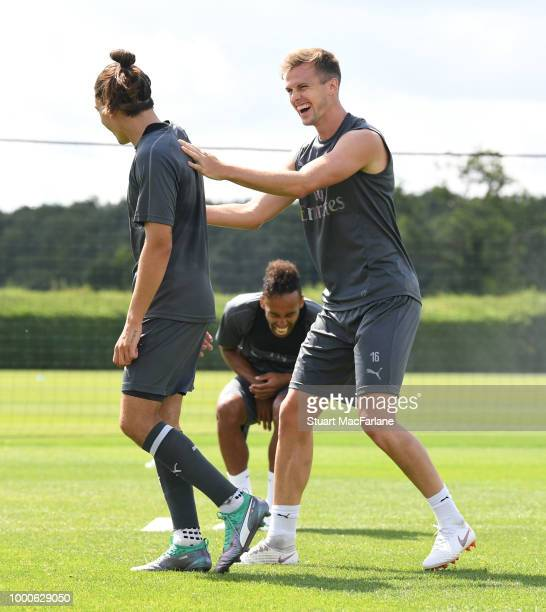Hector Bellerin PierreEmerick Aubameyang and Rob Holding of Arsenal during a training session at London Colney on July 17 2018 in St Albans England