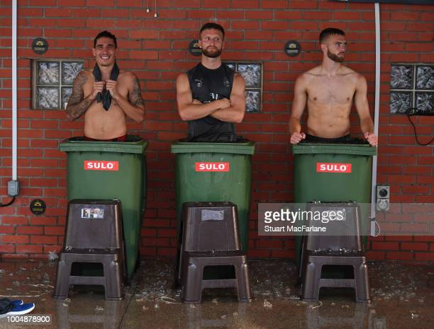 Hector Bellerin Shkodran Mustafi and Calum Chambers of Arsenal take ice baths after a training session at Singapore American School on July 24 2018...