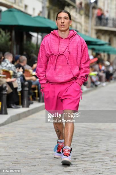 Hector Bellerin walks the runway during the Louis Vuitton Menswear Spring Summer 2020 show as part of Paris Fashion Week on June 20, 2019 in Paris,...