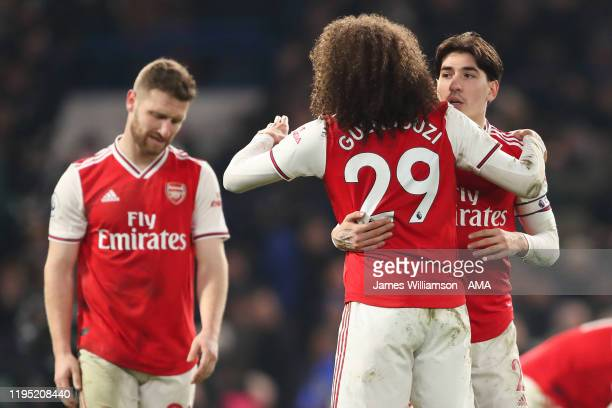 Hector Bellerin with Matteo Guendouzi of Arsenal at full time of the Premier League match between Chelsea FC and Arsenal FC at Stamford Bridge on...