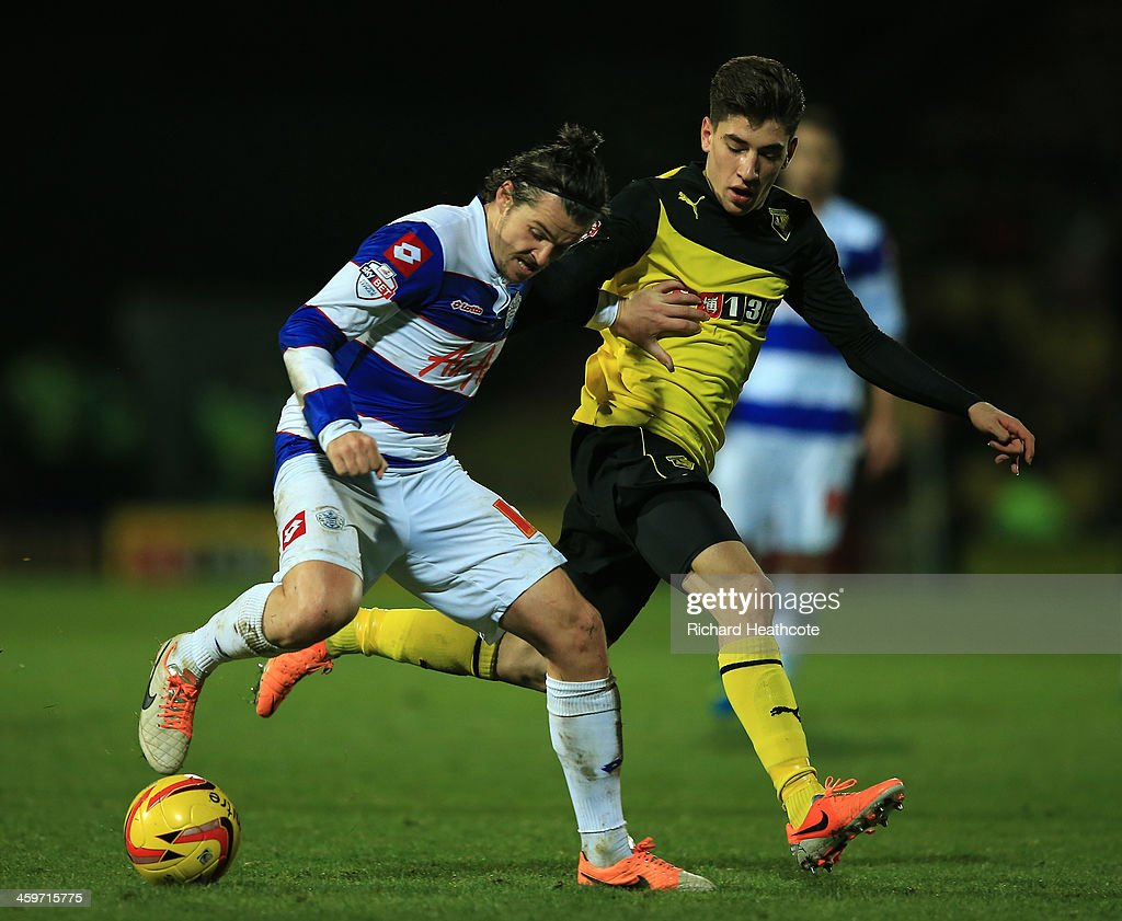 Hector Bellerín of Watford battles with Joey Barton of QPR during the Sky Bet Championship match between Watford and Queens Park Rangers at Vicarage Road on December 29, 2013 in Watford, England,