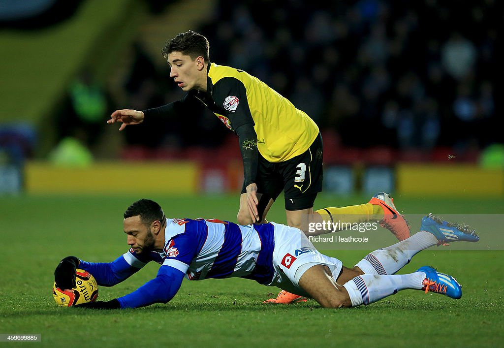Hector Bellerín of Watford tackles Matt Phillips of QPR during the Sky Bet Championship match between Watford and Queens Park Rangers at Vicarage Road on December 29, 2013 in Watford, England,