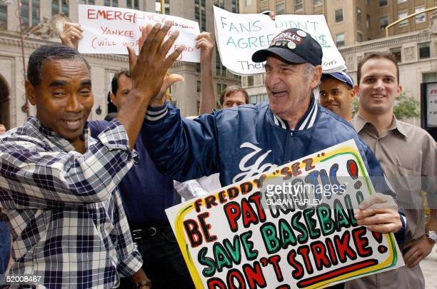 Hector Bodre of Washington Heights celebrates with Freddy Schuman of the Bronx who claims to be the Yankee fan outside of the baseball strike talks...