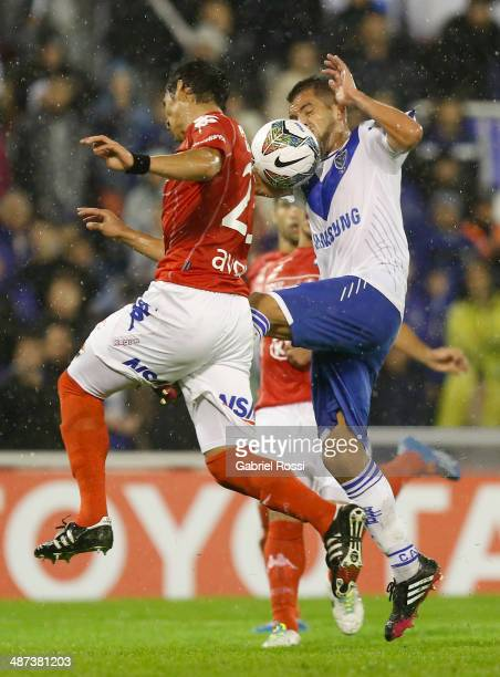 Hector Canteros of Velez Sarsfield fights for the ball with Fabian Balbuena of Nacional during a match between Velez Sarsfield and Nacional as part...