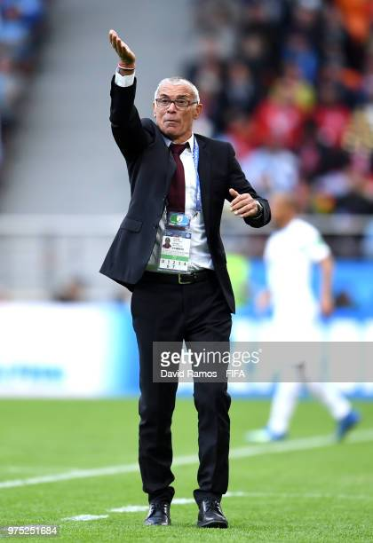Hector Cuper, Head coach of Egypt gives his team instructions during the 2018 FIFA World Cup Russia group A match between Egypt and Uruguay at...