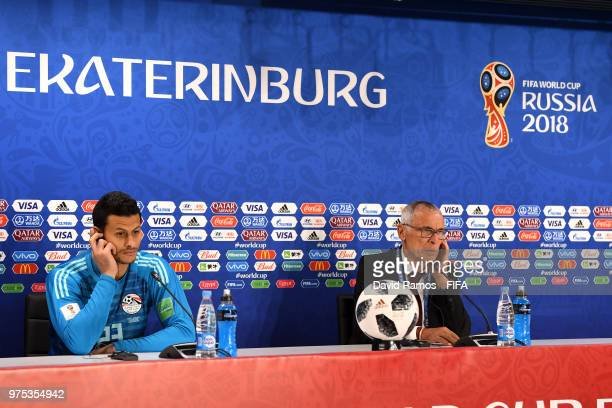 Hector Cuper, Head coach of Egypt speaks, as Mohamed Elshenawy of Egypt looks on during the press conference after the 2018 FIFA World Cup Russia...