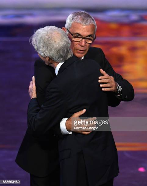 Hector Cuper Manager of Egypt and Jose Pekerman Manager of Columbia embrace during the Final Draw for the 2018 FIFA World Cup Russia at the State...
