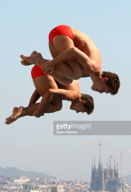 Hector Garcia and Nicolas Garcia of Spain compete in the Men's 3m Synchro Springboard Diving preliminary round on day four of the 15th FINA World...