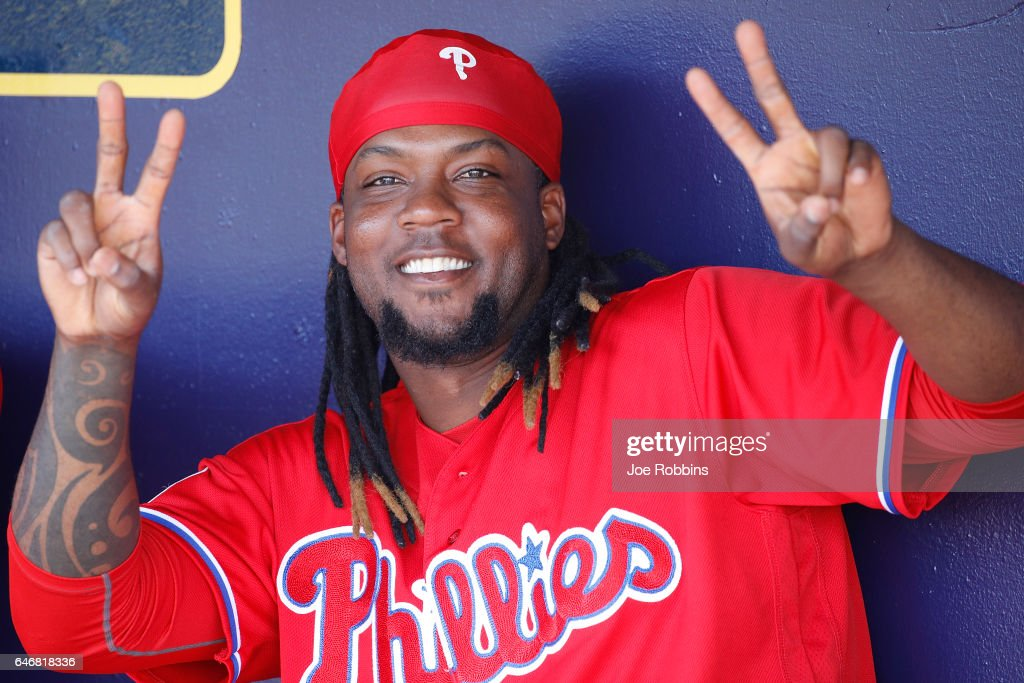 Hector Gomez #62 of the Philadelphia Phillies jokes around in the dugout prior to a Grapefruit League spring training game against the Tampa Bay Rays at Charlotte Sports Park on March 1, 2017 in Port Charlotte, Florida.