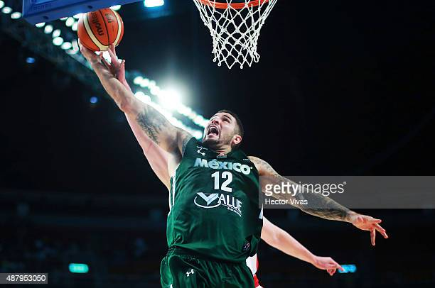 Hector Hernandez of Mexico goes up against Kelly Olynyk of Canada during a third place match between Canada and Mexico as part of the 2015 FIBA...