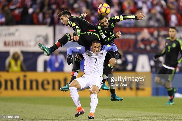 Hector Herrera and Rafael Marquez of Mexico jump for the ball over Bobby Wood of USA during the match between USA and Mexico as part of FIFA 2018...