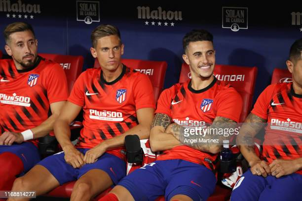 Hector Herrera Marcos Llorente and Mario Hermoso of Atletico Madrid look on from the bench prior to the Liga match between Club Atletico de Madrid...