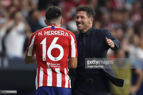 Hector Herrera of Atletico Madrid and Diego Simeone Manager of Atletico Madrid celebrate during the UEFA Champions League group D match between...