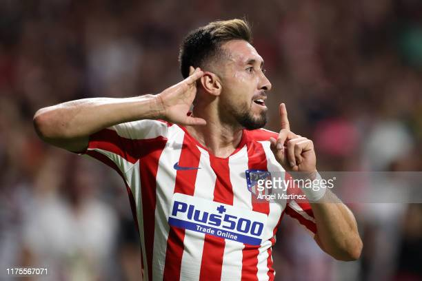 Hector Herrera of Atletico Madrid celebrates after scoring his sides second goal during the UEFA Champions League group D match between Atletico...