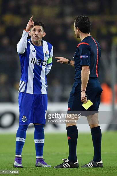 Hector Herrera of FC Porto appeals to refere Luca Banti during the UEFA Europa League round of 32 first leg match between Borussia Dortmund and FC...