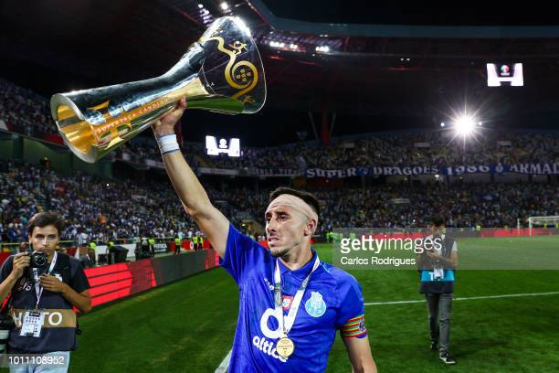 Hector Herrera of FC Porto celebrates with the Portuguese SuperCup trophy after the match between FC Porto and Desportivo das Aves for the Portuguese...