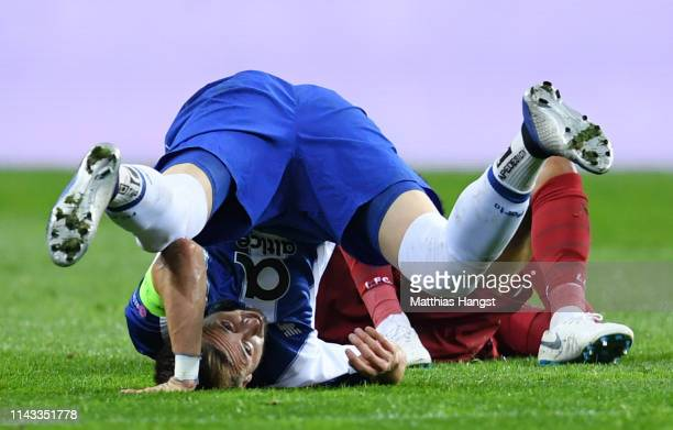 Hector Herrera of FC Porto falls oupside down during the UEFA Champions League Quarter Final second leg match between Porto and Liverpool at Estadio...