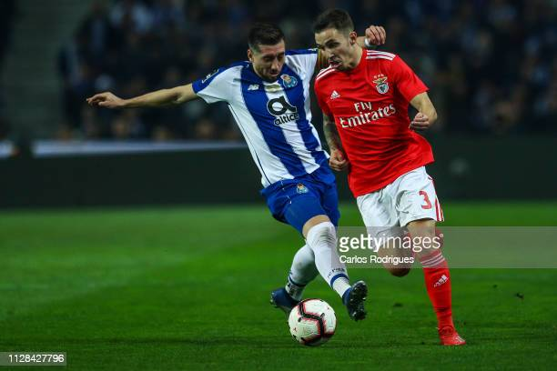 Hector Herrera of FC Porto vies with Alex Grimaldo of SL Benfica during the Liga NOS match between FC Porto and SL Benfica at Estadio do Dragao on...
