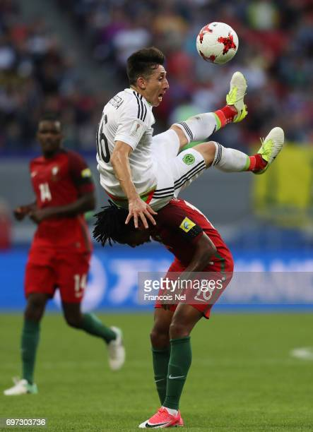 Hector Herrera of Mexico and Gelson Martins of Portugal compete for the ball during the FIFA Confederations Cup Russia 2017 Group A match between...