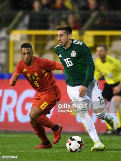 Hector Herrera of Mexico and Youri Tielemans of Belgium compete for the ball during the international friendly match between Belgium and Mexico at...
