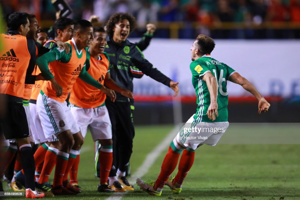 Hector Herrera of Mexico celebrate with teammates after scoring the third goal of his team during the match between Mexico and Trinidad & Tobago as part of the FIFA 2018 World Cup Qualifiers at Alfonso Lastras Stadium on October 6, 2017 in San Luis Potosi, Mexico.