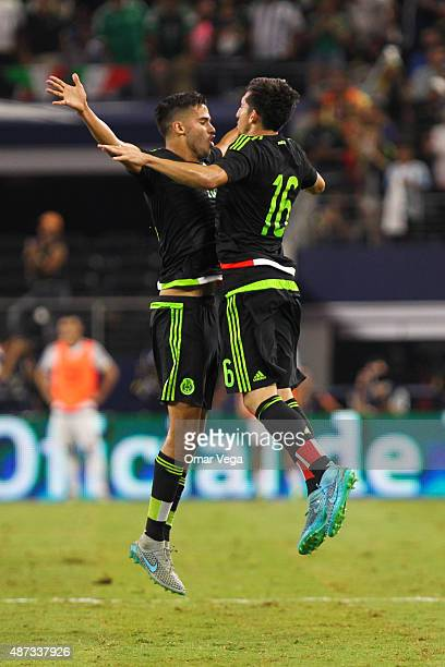 Hector Herrera of Mexico celebrates after scoring the second goal of his team during a friendly match between Argentina and Mexico at ATT Stadium on...