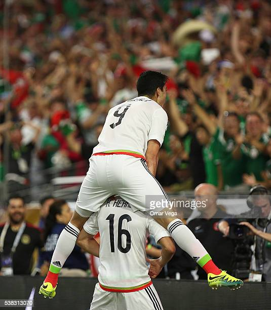 Hector Herrera of Mexico celebrates with teammate Raul Jimenez after scoring during a group C match between Mexico and Uruguay at University of...