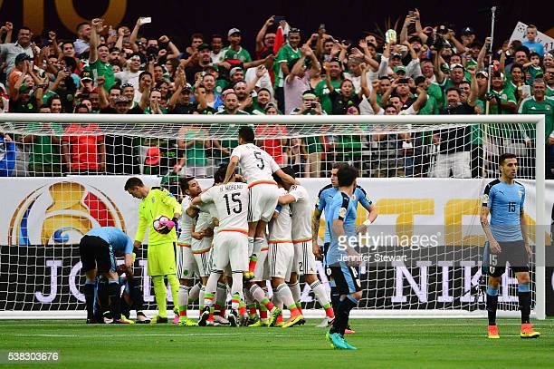 Hector Herrera of Mexico celebrates with teammates after a first period goal during the 2016 Copa America Centenario Group C match against Uruguay at...