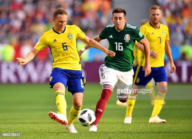 Hector Herrera of Mexico challenges Ludwig Augustinsson of Sweden during the 2018 FIFA World Cup Russia group F match between Mexico and Sweden at...