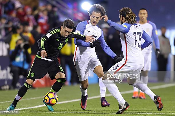 Hector Herrera of Mexico fights for the ball with Jermaine Jones of USA during the match between USA and Mexico as part of FIFA 2018 World Cup...