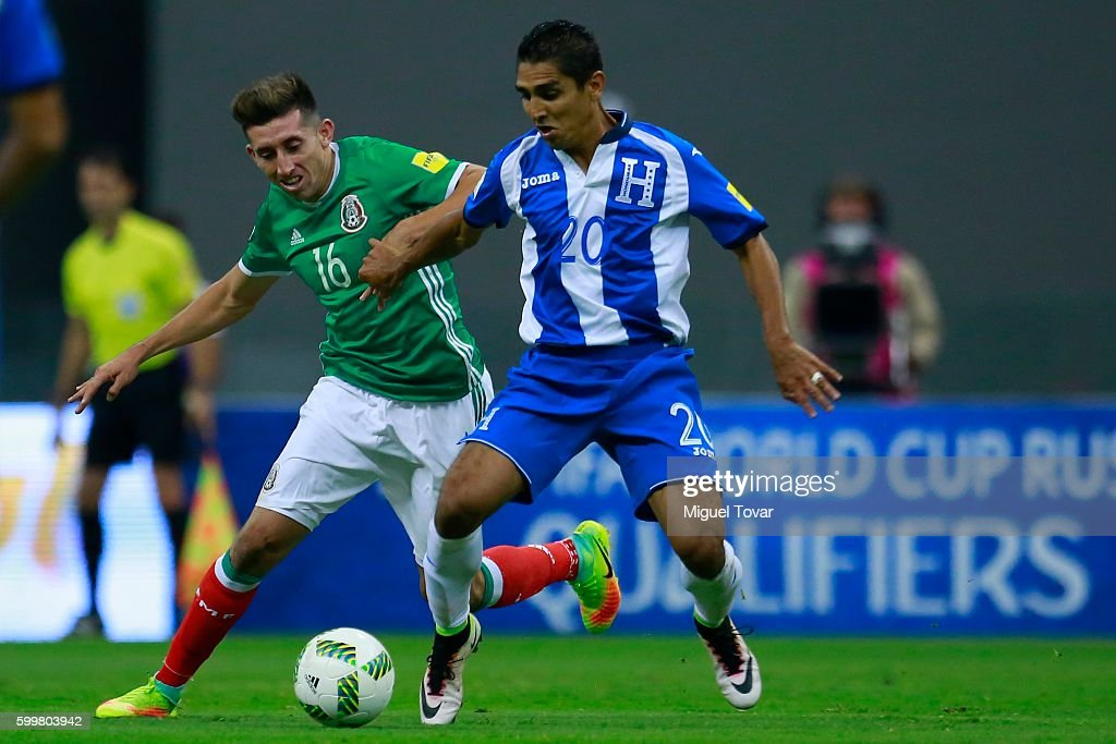 Hector Herrera of Mexico (L) fights for the ball with Jorge Claros of Honduras (R) during a match between Mexico and Honduras as part of FIFA 2018 World Cup Qualifiers at Azteca Stadium on September 06, 2016 in Mexico City, Mexico.