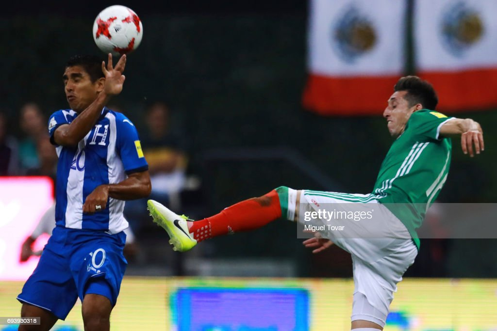 Hector Herrera of Mexico (R) fights for the ball with Jorge Claros of Honduras (L) during the match between Mexico and Honduras as part of the FIFA 2018 World Cup Qualifiers at Azteca Stadium on June 08, 2017 in Mexico City, Mexico.