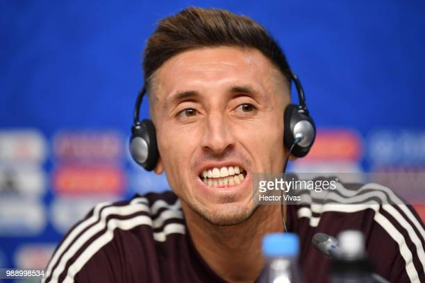 Hector Herrera of Mexico gestures during a press conference at Samara Arena ahead of the Round of Sixteen match against Brazil on July 1 2018 in...