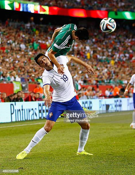 Hector Herrera of Mexico goes up for a header over Andre Almeida of Portugal in the second half during the international friendly match at Gillette...