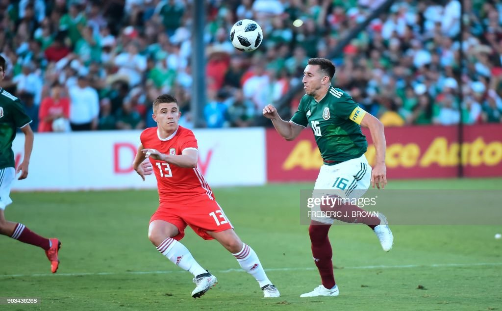 Hector Herrera of Mexico (R) vies for the ball with Declan John of Wales (L) during their international soccer friendly at the Rose Bowl in Pasadena, California on May 28, 2018 where the game ended 0-0.