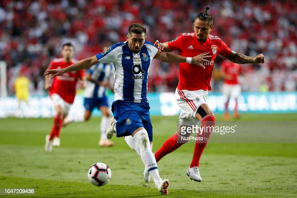 Hector Herrera of Porto vies for the ball with Ljubomir Fejsa of Benfica during the Portuguese League football match between SL Benfica and FC Porto...