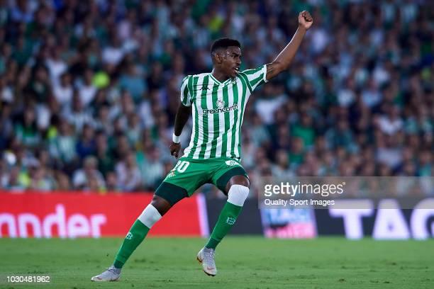 Hector Junior Firpo Adames of Real Betis reacts during the La Liga match between Real Betis Balompie and Sevilla FC at Estadio Benito Villamarin on...